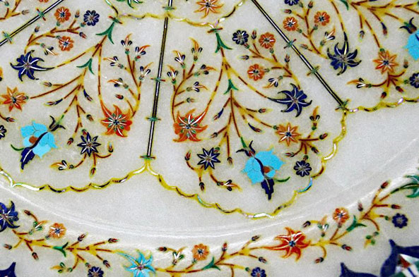Close-up of a very intricate dinner plate, made with over 12,000 pieces.