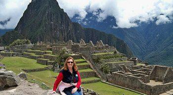 Woman sits at Machu Picchu