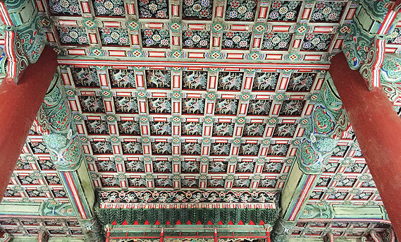 Intricate details on the ceiling of a South Korean structure.