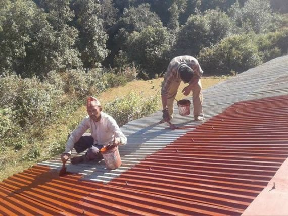 Men painting a roof