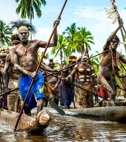 Group of Asmat people in a canoe