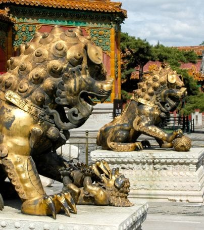 Lion statues in front of building in China