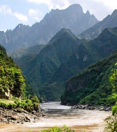 River runs between mountain peaks in China