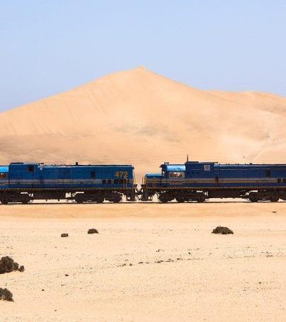 Train runs through desert near Swakopmund, Namibia