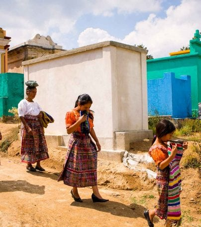 People walk through colorful Guatemala cemetery