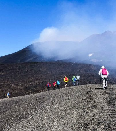 People climb Mount Etna in Italy