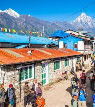 People wander street in Lukla, Nepal