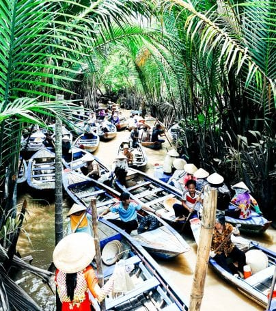 Group of boats travels on river of Mekong Delta