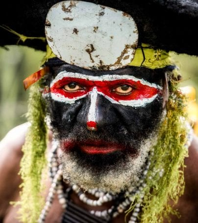 Man with painted face at Mount Hagen, Papua New Guinea
