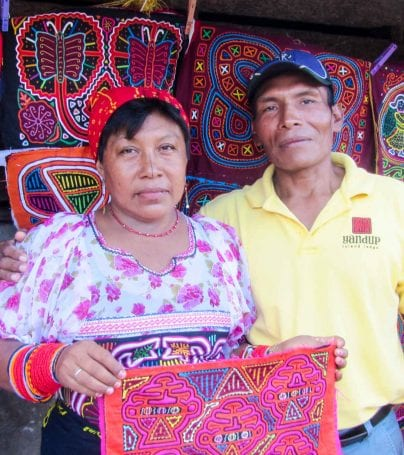 Man and woman hold colorful fabrics in Panama