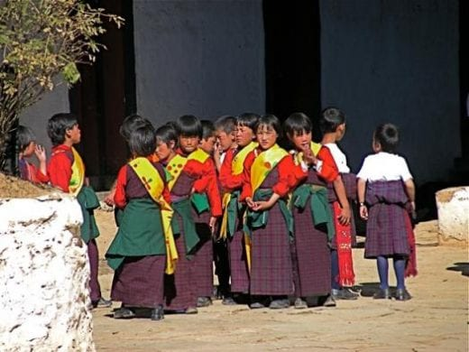 Bhutanese school children prepare to dance at the Crane Festival