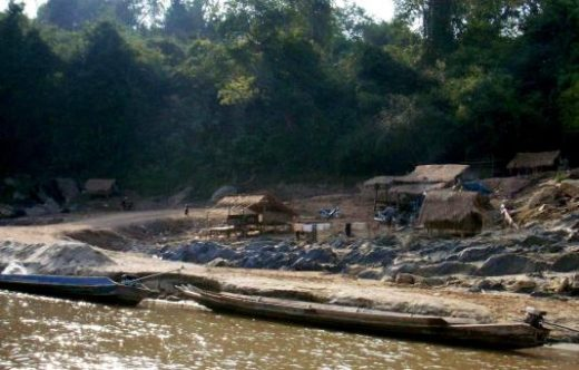 See village life on a boat trip along the Mekong River