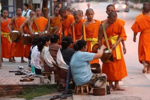 Join in offering alms to Buddhist monks