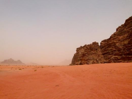 Admire the vivid morning hues of Wadi Rum