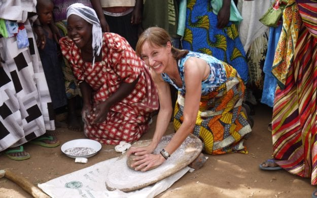 women in Uganda preparing dough