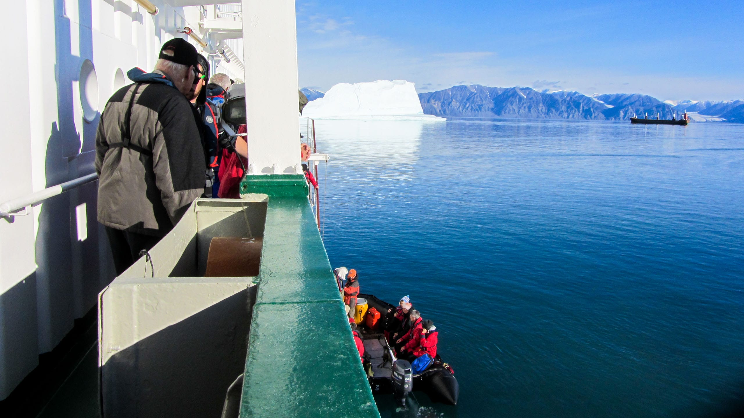 Travelers look at Arctic view from ship
