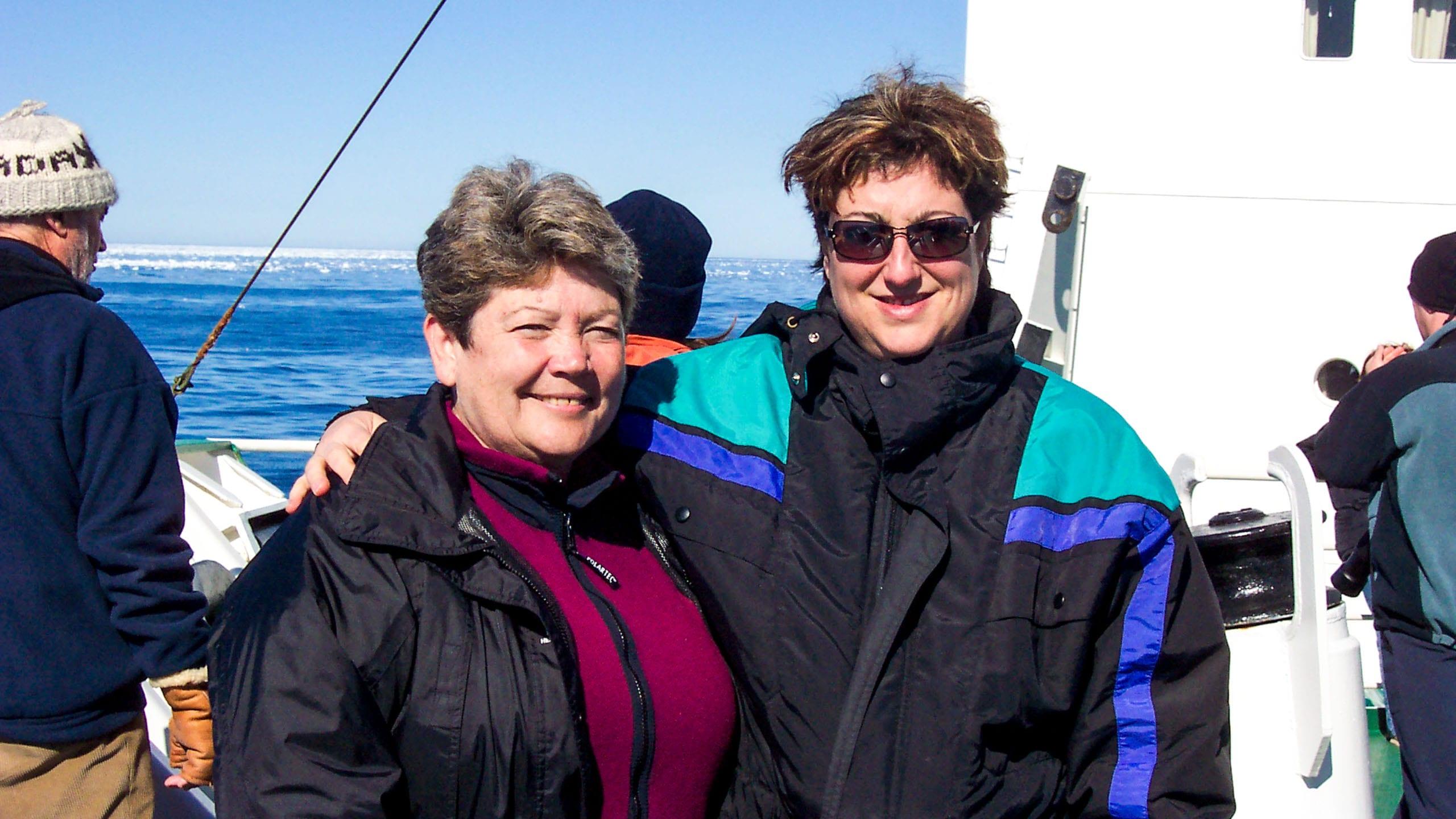 Women pose on ship during arctic trip