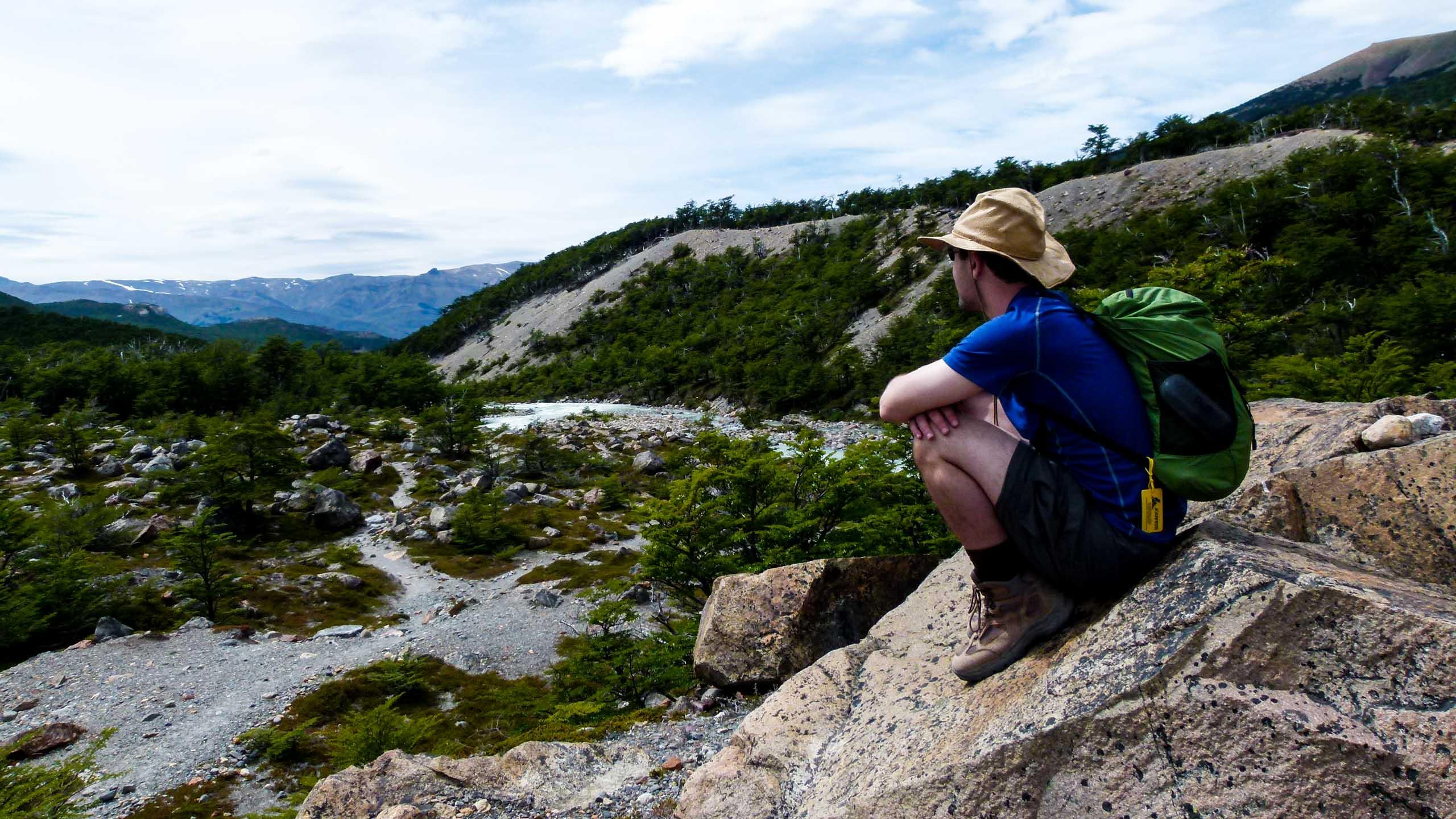 Hiker sits on Argentina rocks