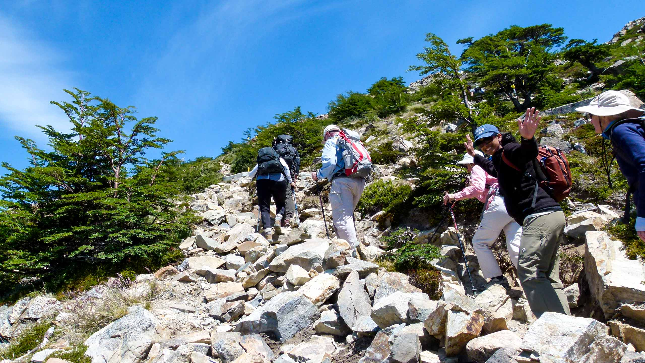 Hiking group climbs rocky trail in Argentina