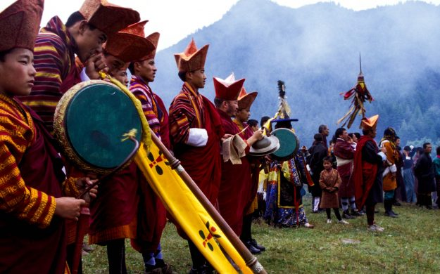 Bhutan festival performers with instruments