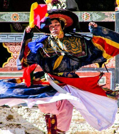 Colorfully dressed Bhutan man dances at festival