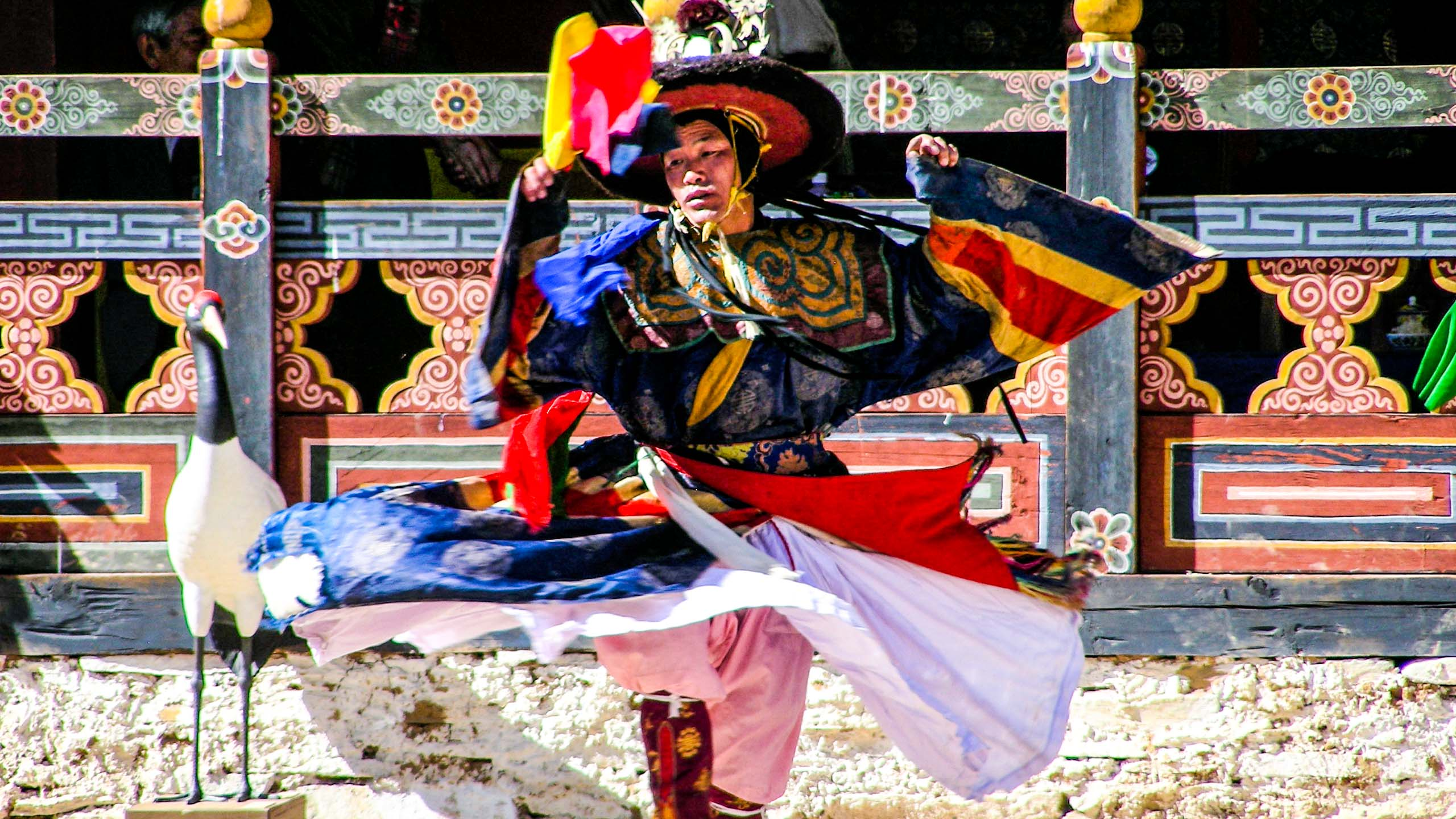 Colorfully dressed Bhutan man dances at festival