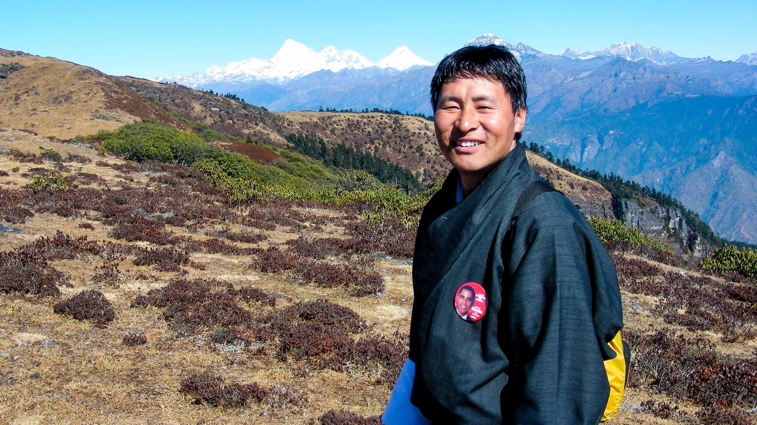 Bhutan man hikes through mountains