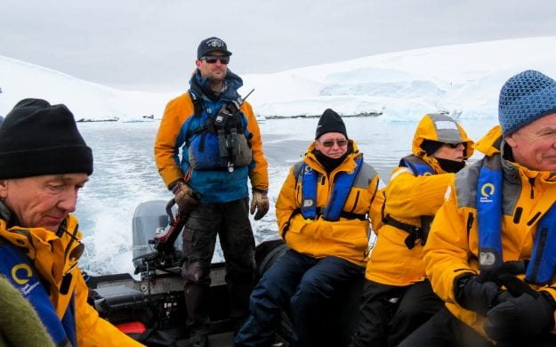 Group of travelers rides boat in Antarctica