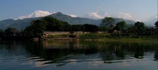 The Annapurna range looms above Phewa Lake