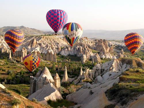 Float above rock valleys and amazing scenery in Cappadocia