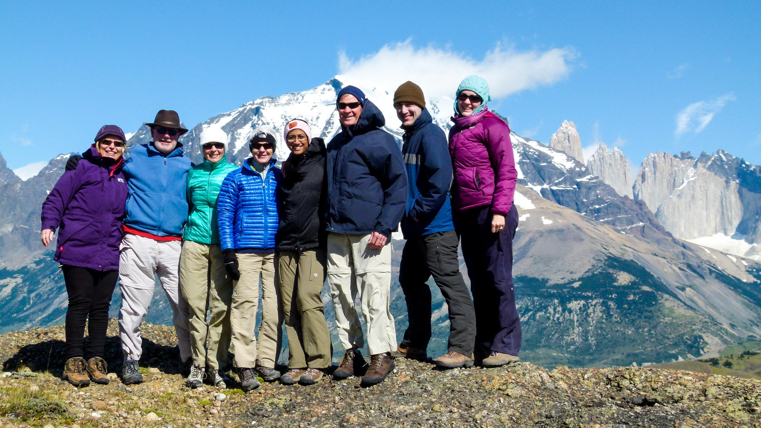 Group of travelers stand high in Chile mountains