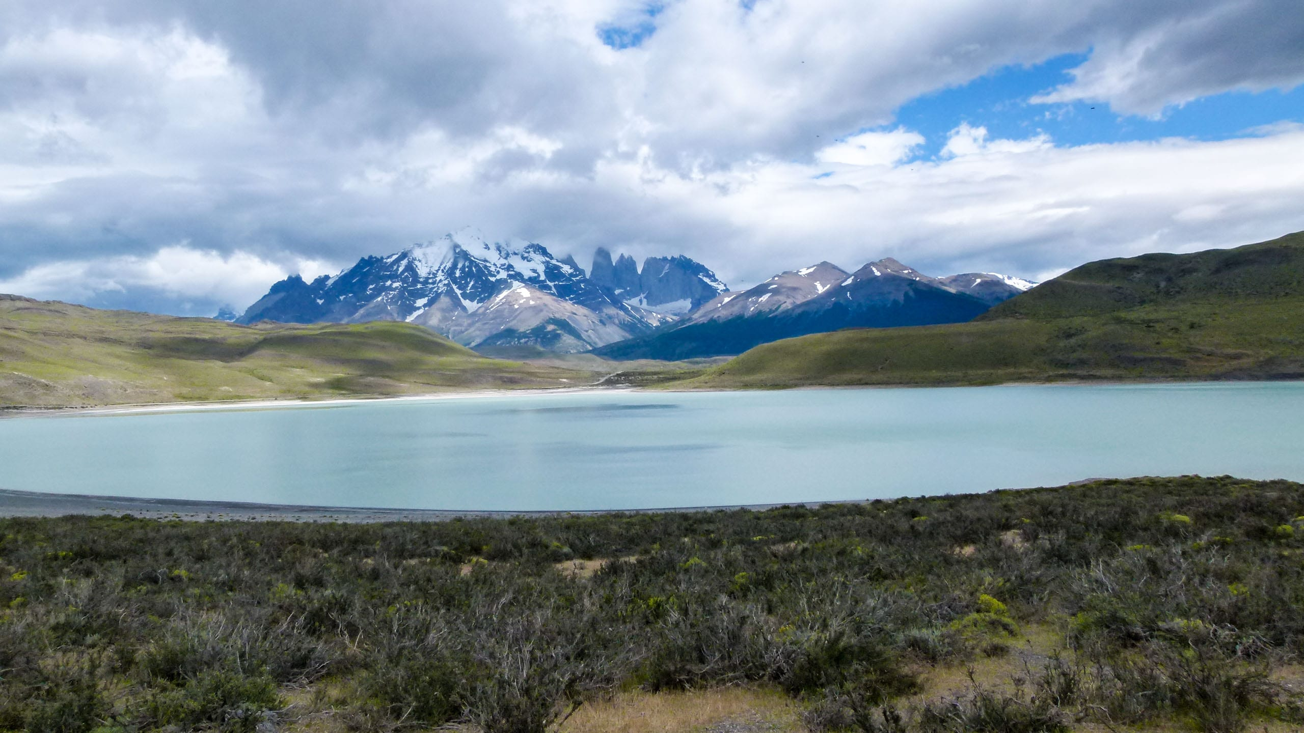 View of Patagonia mountains across lake
