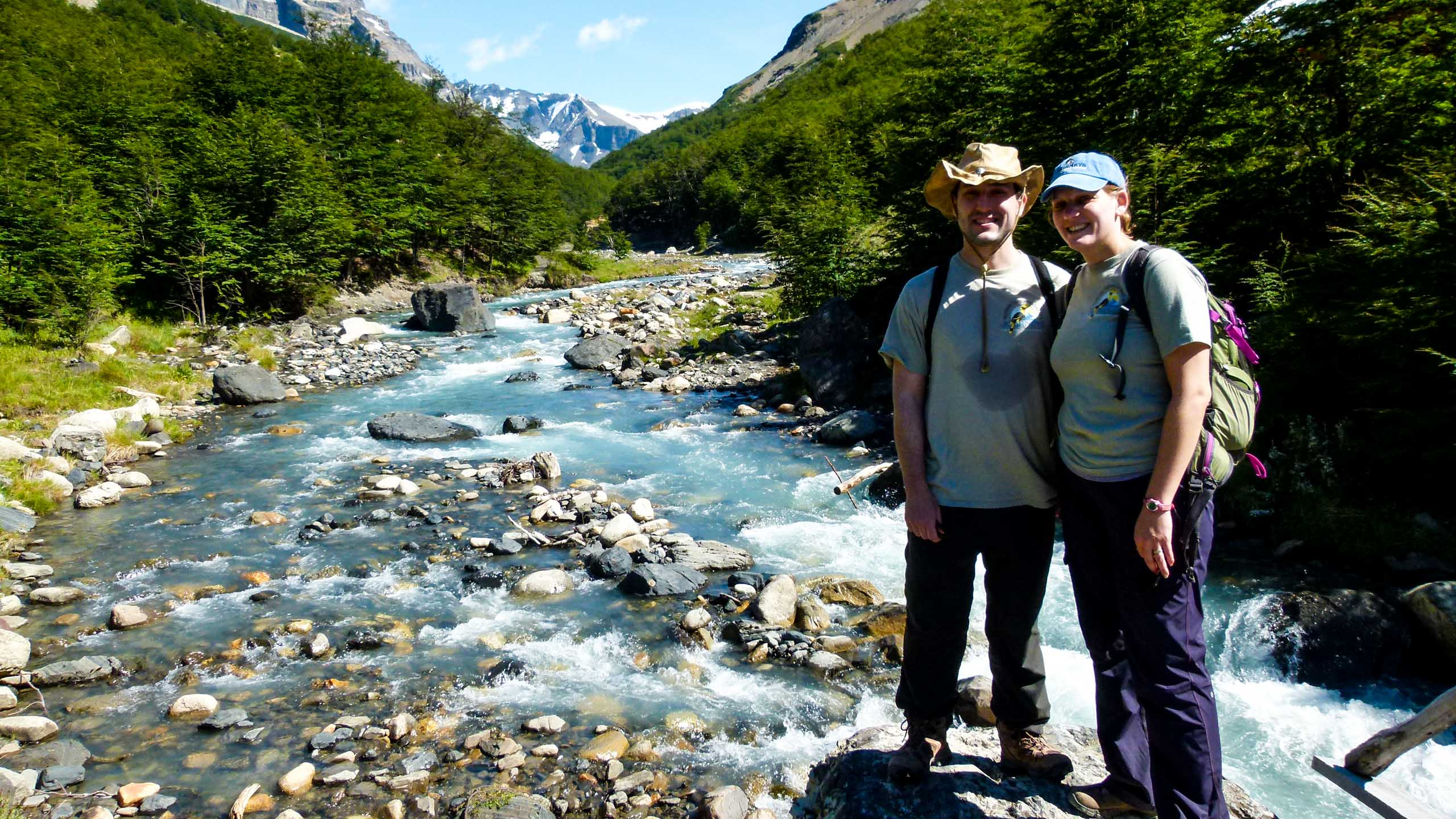 Hikers stand in Chile stream