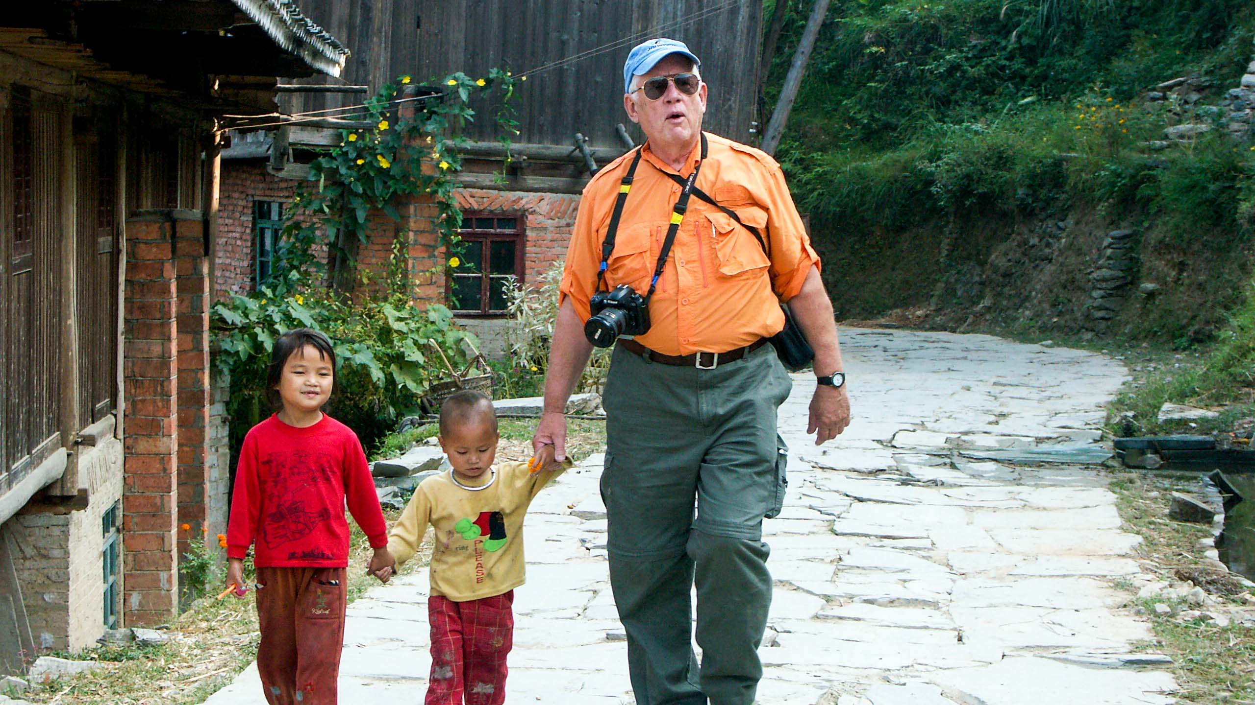 Traveler walks with young Chinese children