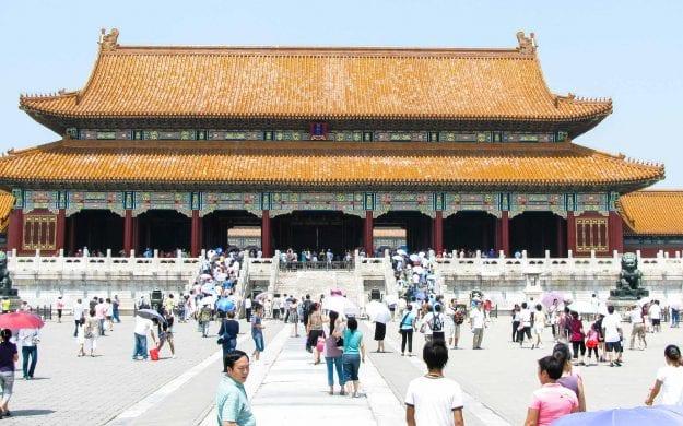 Travelers wander around China palace plaza