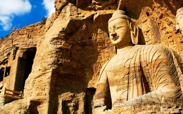 A giant stone Buddha carving in Yungang, China