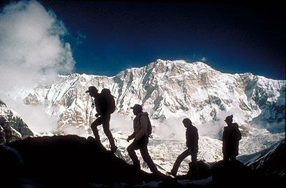 Morning hikers with the Himalayas in the background