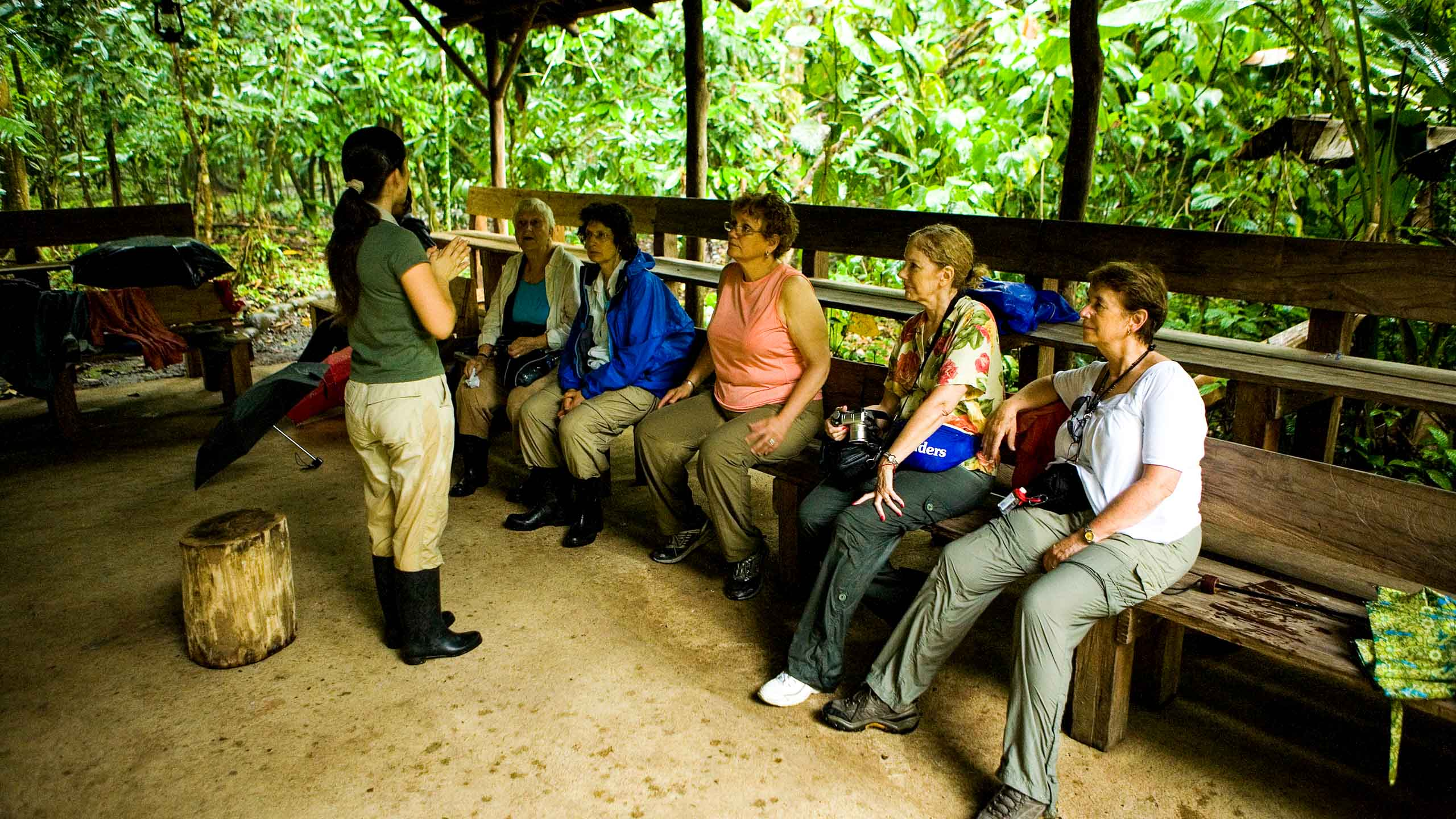 Tour guide speaks to group of travelers in Costa Rica