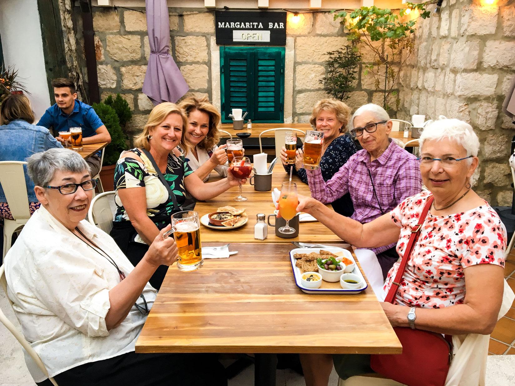 Table of women cheers in Croatia