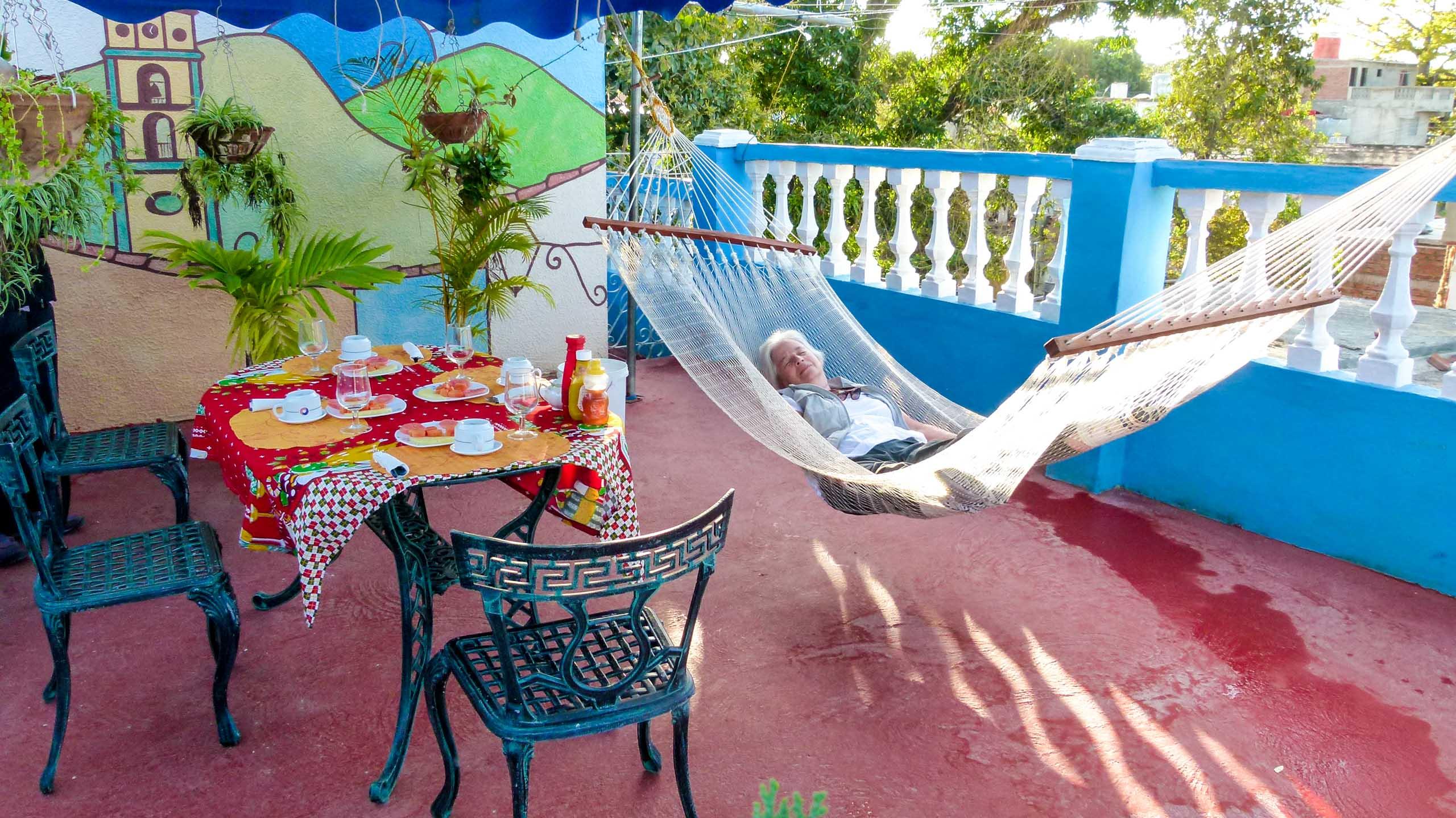 Woman rests in hammock in Cuba