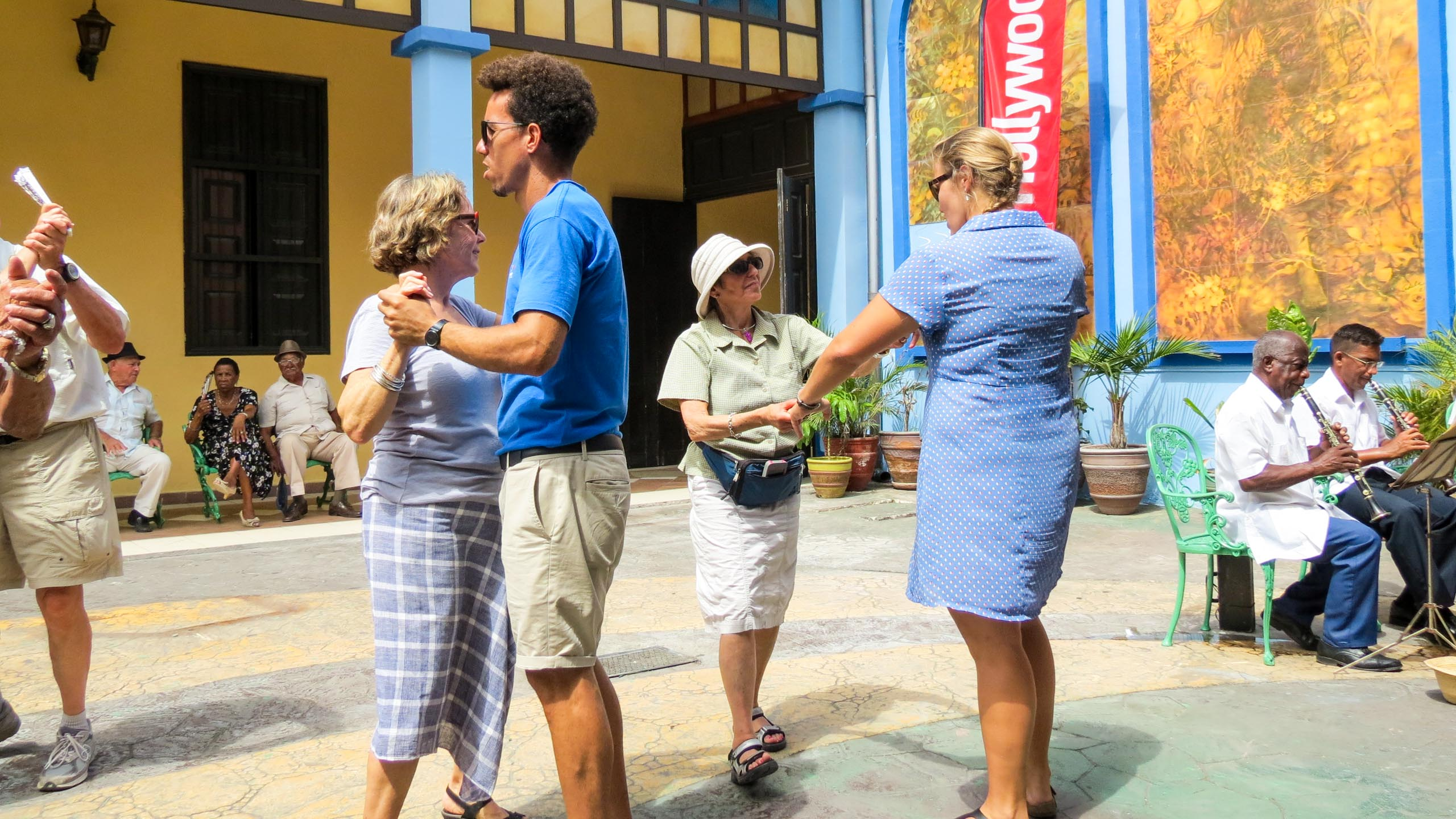 Travelers dance in Cuba