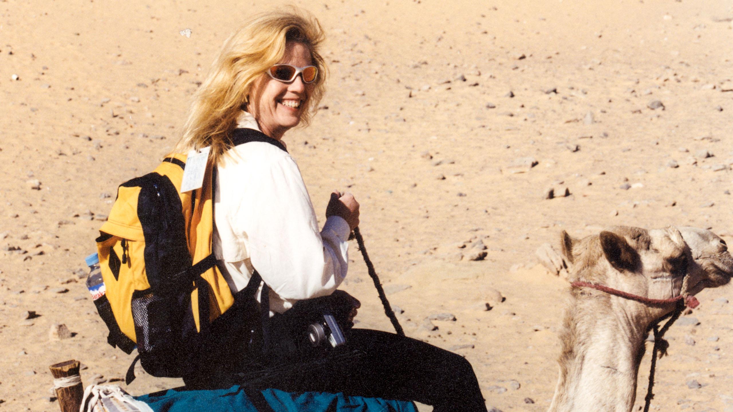 Woman riding camel on Egypt trip