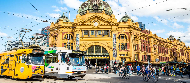 People and trains on Flinders Street in Melbourne, Australia