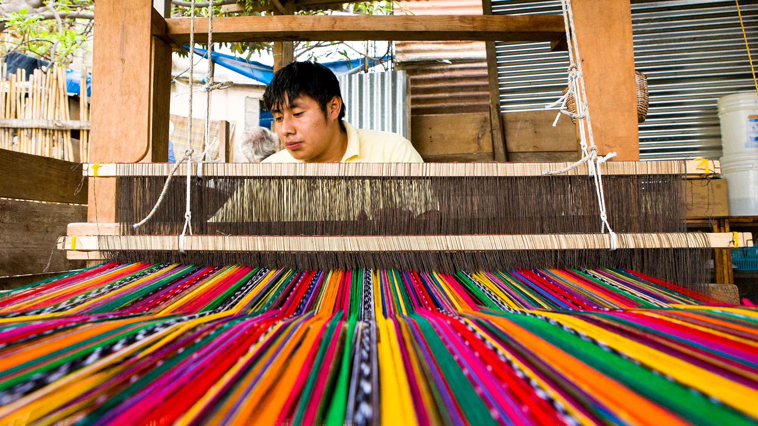 Man weaves colorful textiles in Guatemala