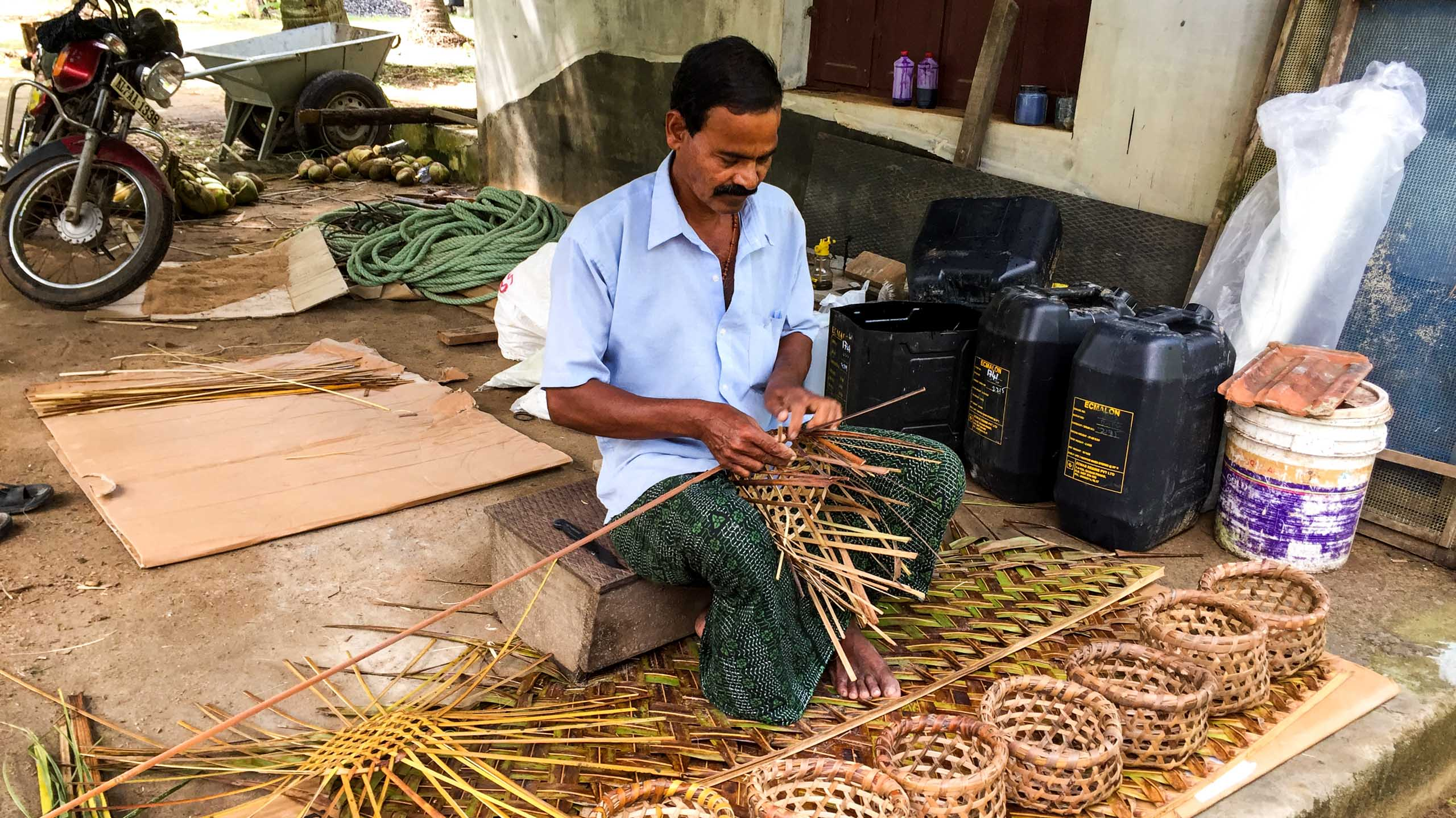Indian man weaves baskets