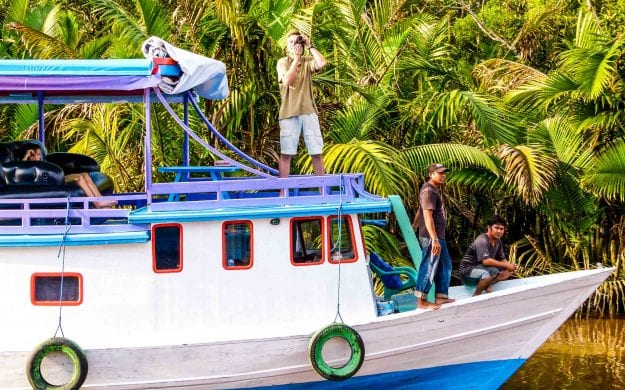 Traveler takes picture from Indonesia boat tour