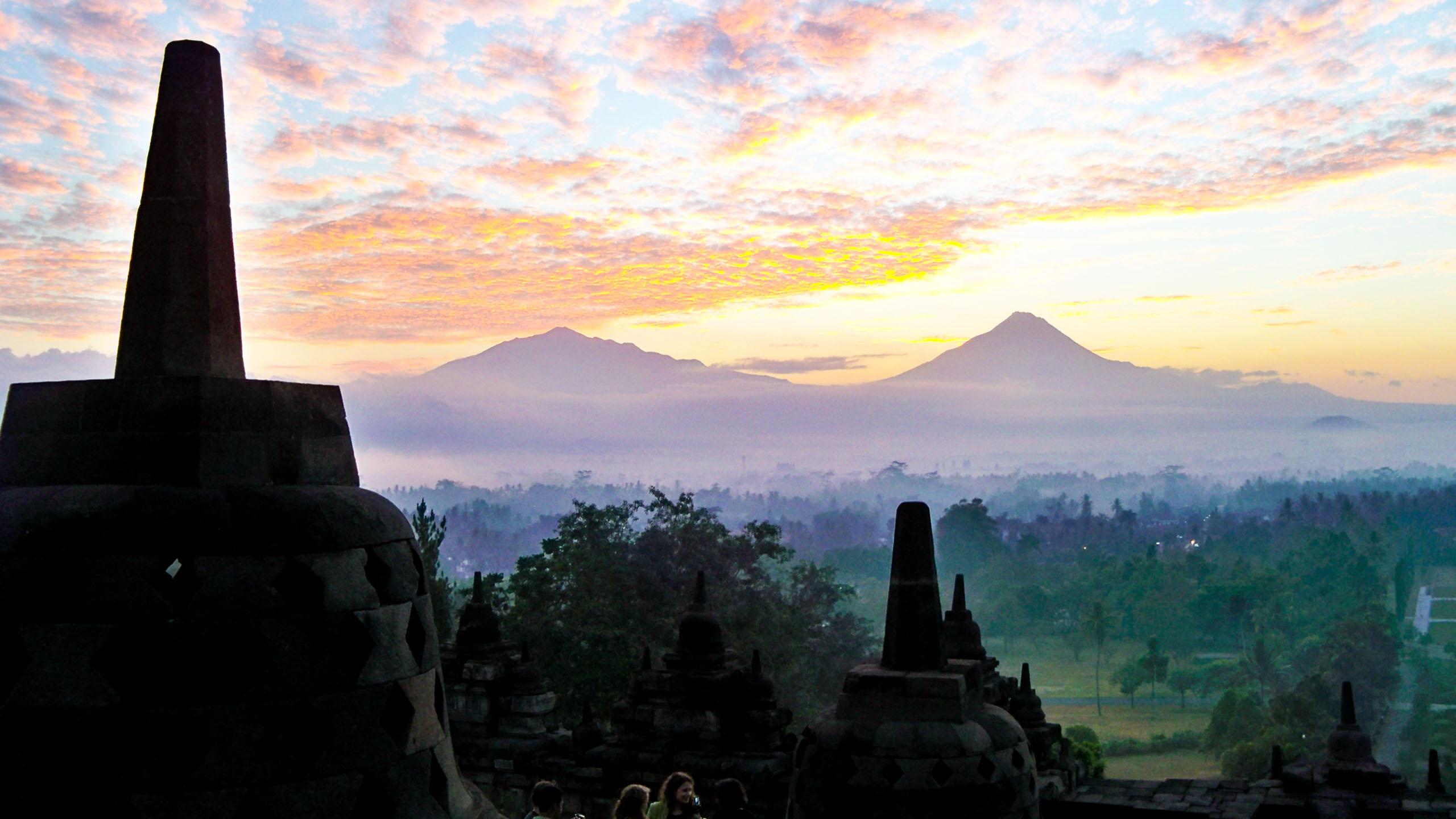Yogyakarta monuments against misty Indonesia landscape