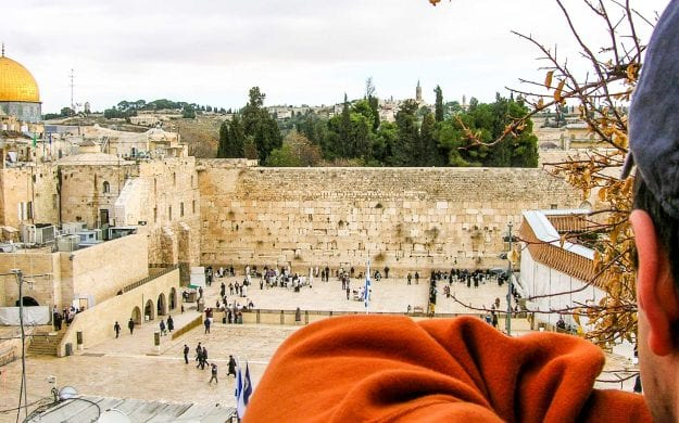 Traveler looks over view of Jerusalem