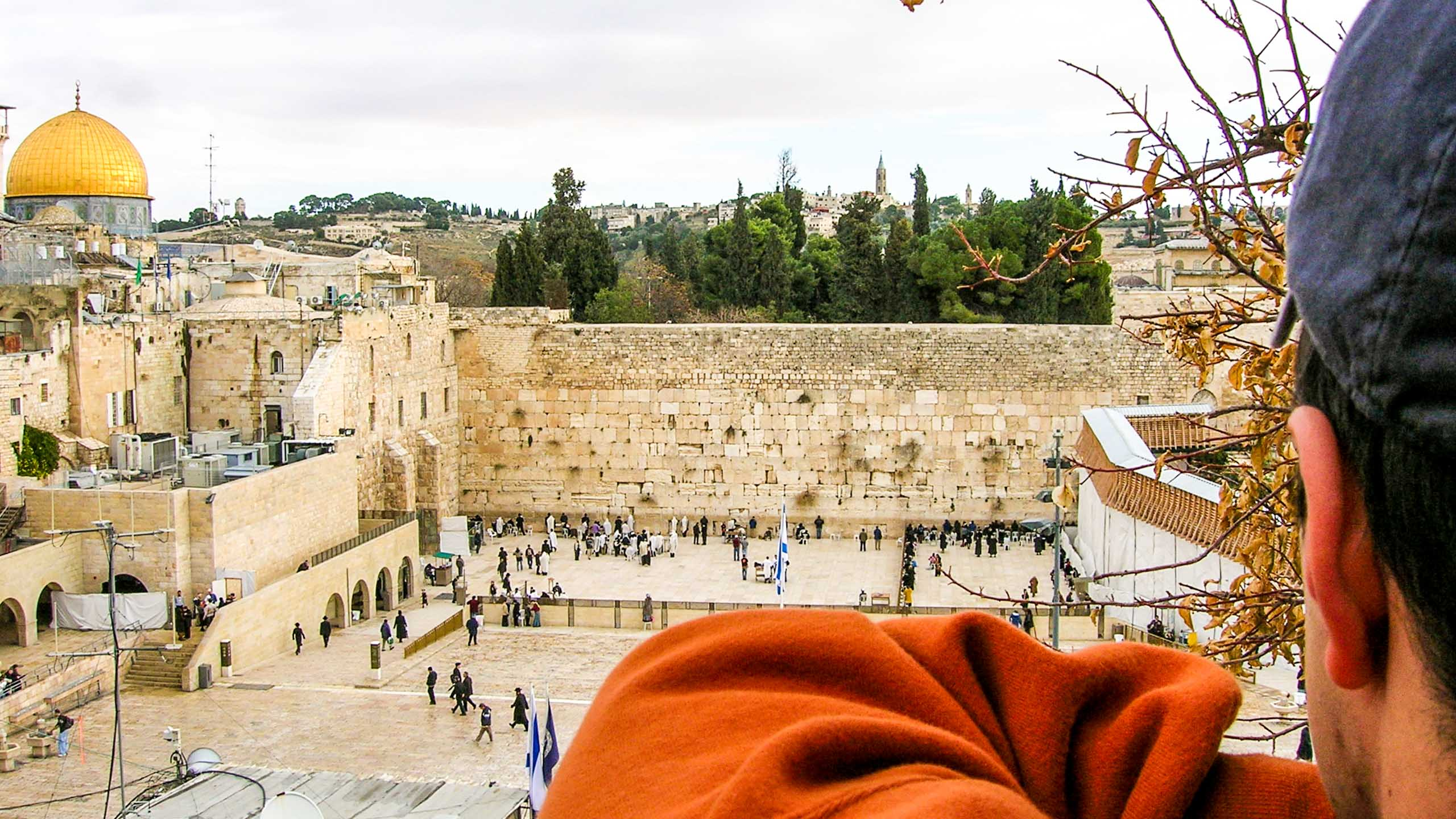 Traveler looks over view of Jerusalem