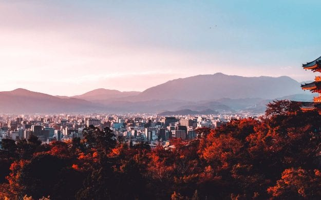 Pagoda rises above skyline of Kyoto, Japan